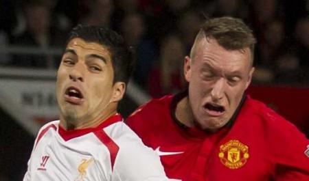 Suarez and Phil Jones exchange gurns