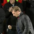 Brendan Rodgers celebrates Liverpool's third goal v Bournemouth