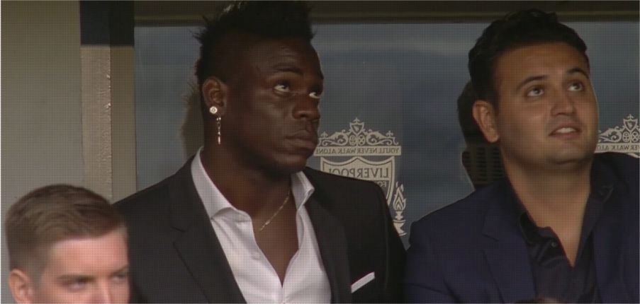 Mario Balotelli watches the game at Anfield