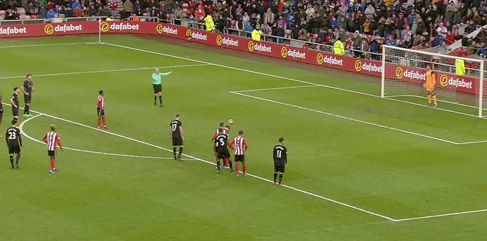 Defoe scores a penalty against Liverpool