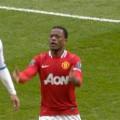 Patrice Evra and Luis Suarez