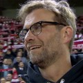 Jurgen Klopp watches on as the fans sing YNWA