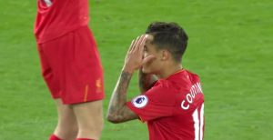 Coutinho sees a shot tipped wide by David De Gea