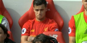 Coutinho relaxes on the bench after helping Liverpool beat Everton