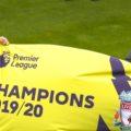 Klopp and captain Henderson are Premier League title winners
