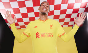Virgil van Dijk shows off the new Liverpool kit